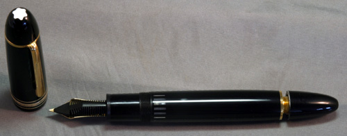 "MONTBLANC 149. Clip ring marked ""GERMANY"". 14K fine two tone nib. Metal filling unit"