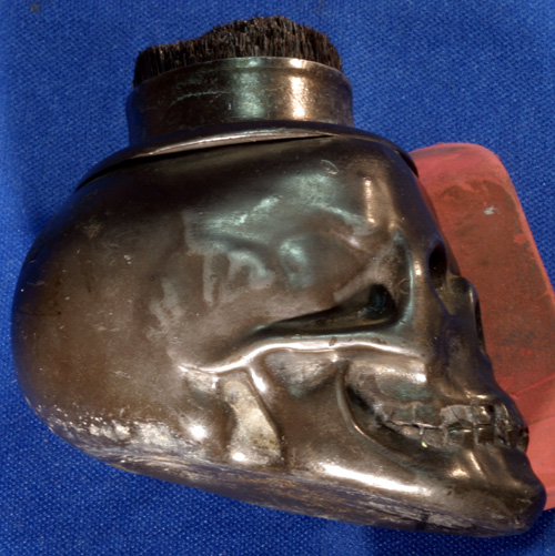 SKULL SHAPED VICTORIAN PEN CLEANER WITH HAT ON