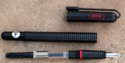 ROTRING ALTRO. Fine steel nib and piston converter filling unit.