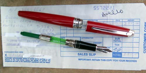 CARAN d'ACHE. Red w/ Rhodium plated trim and 18K/750 Broad nib.