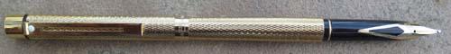 SHEAFFER SLIM TARGA IN GOLD PLATED DIAMOND PATTERN. NEW OLD STOCK