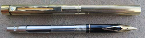 SHEAFFER SLIM TARGA IN GOLD PLATED LINED PATTERN. NEW OLD STOCK. Includes a hard to find Slim Targa converter. Medium 14K nib.