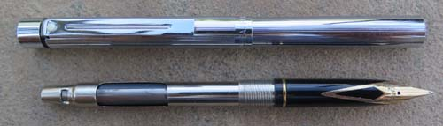 SHEAFFER SLIM TARGA IN CHROME FINISH. NEW OLD STOCK. Includes a hard to find Slim Targa converteR. 14K broad / medium nib - right on the border.